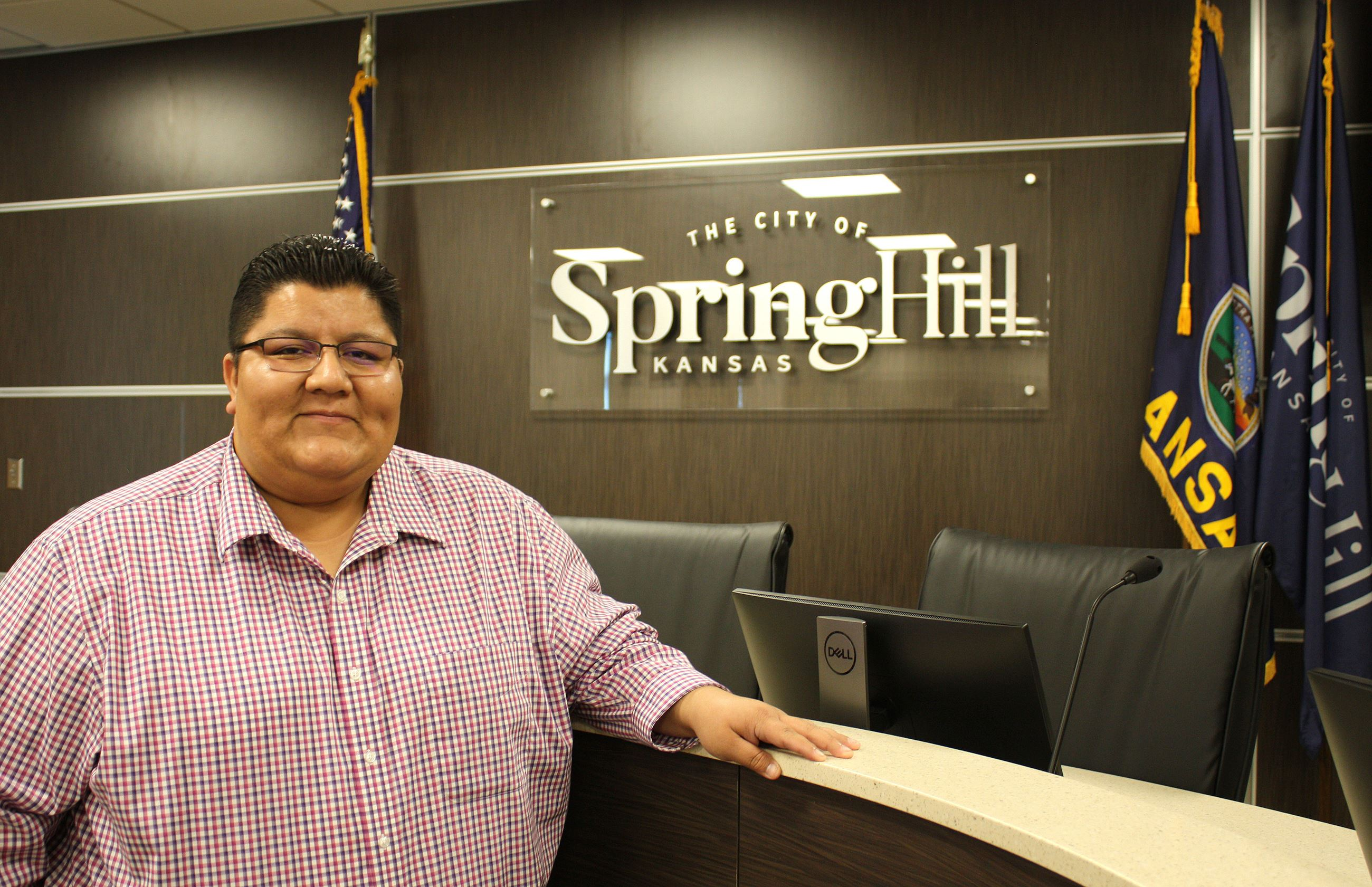 Jose Leon poses in front of a City of Spring Hill sign at the Spring Hill Civic Center