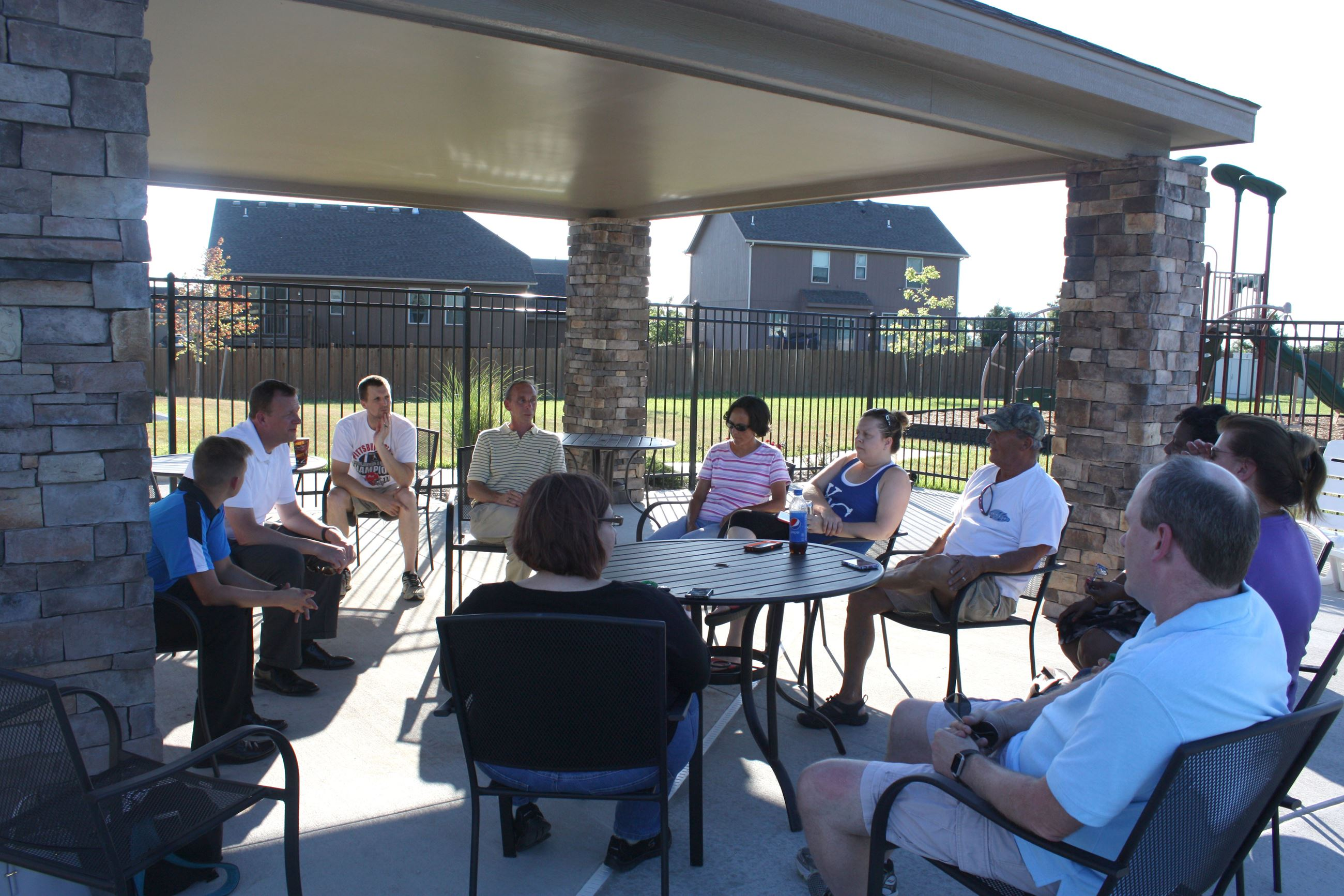 Mayor Steve Ellis sits in a circle with Spring Hill residents outside during a previous Walk and Tal