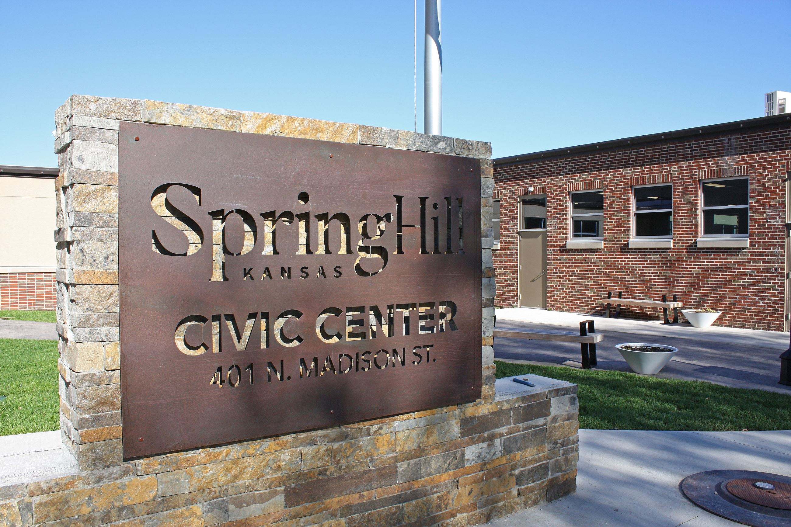 An outdoor image of the Spring Hill Civic Center sign and courtyard.