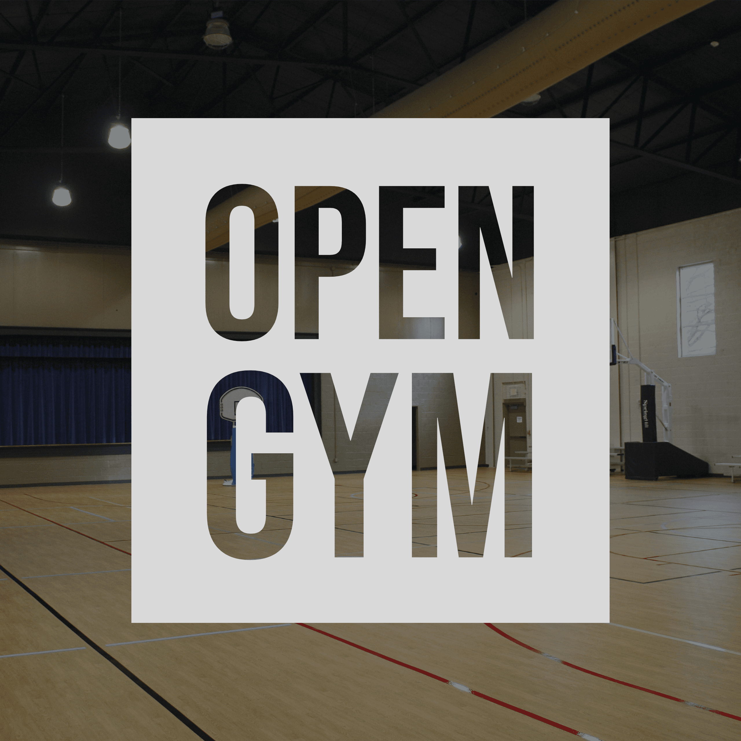 Dark image of the Civic Center gymnasium with the words &#34Open Gym&#34 overlaid.