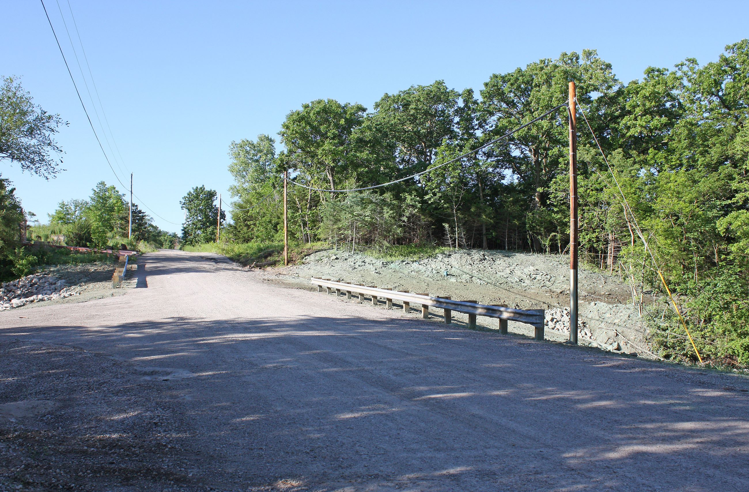 An image of the newly-reopened Lone Elm Road bridge between U.S. 169 and North Street. The image fac
