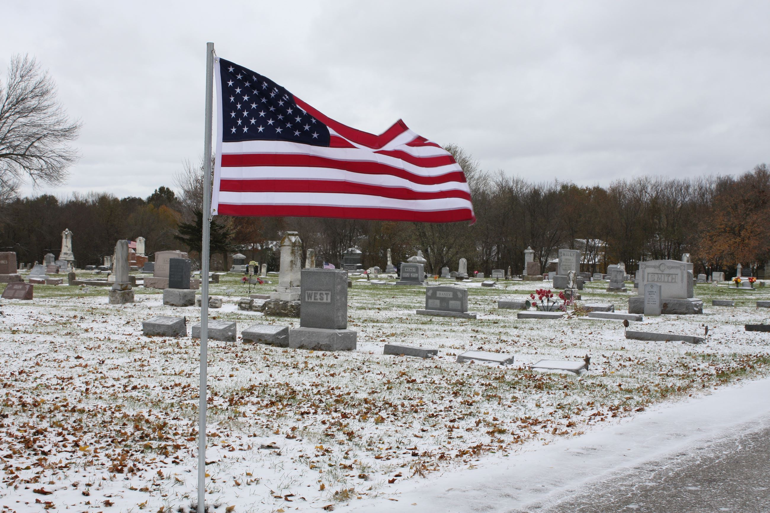 Flag waving in wind at Spring Hill Cemetery