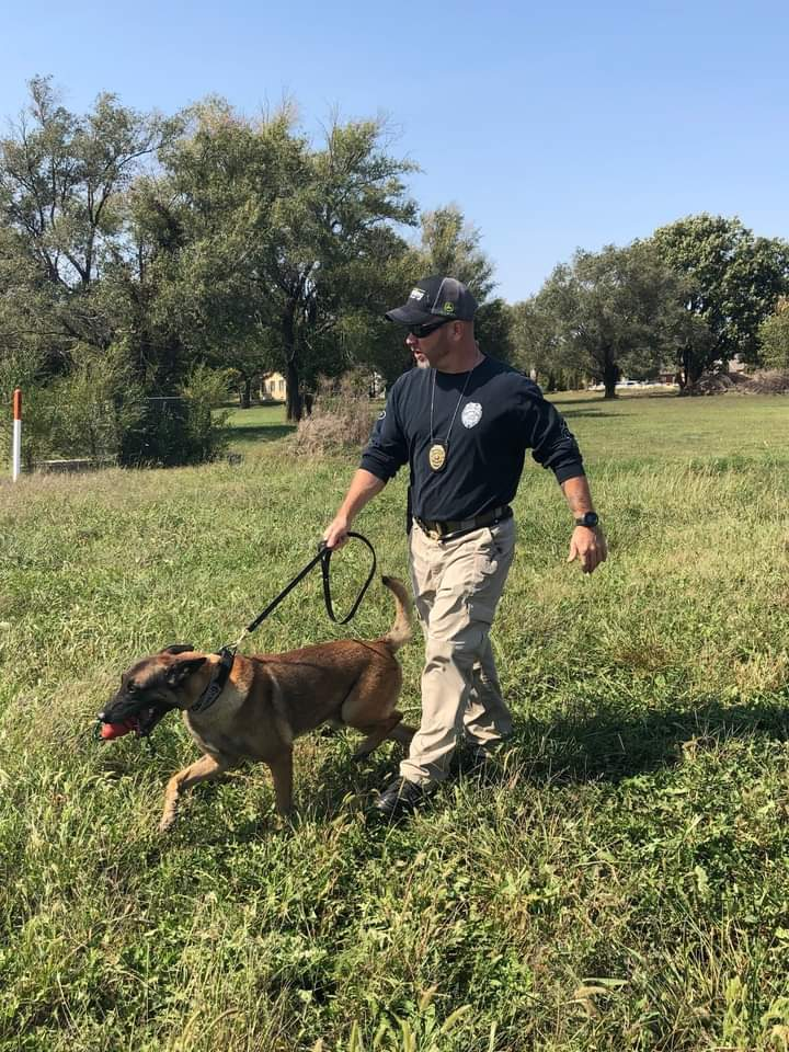 Sgt. Wipf and Niko walking through a field