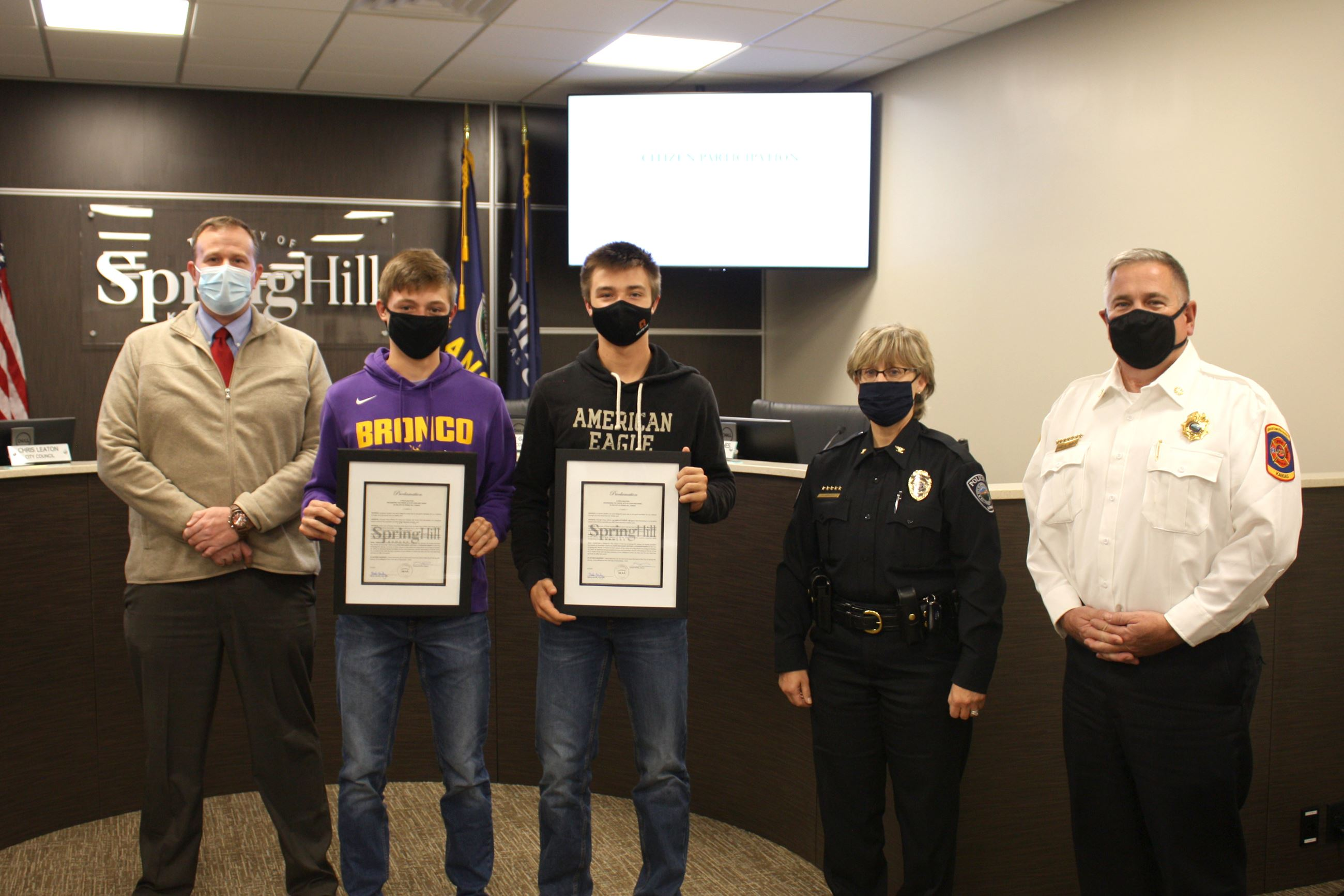 John and Daniel Mitchell receive their proclamations from Mayor Steven Ellis, Spring Hill Police Chi